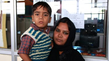 Hazara Khan, who was two at the time of the disaster, with her son Aman Age Khan, who suffers from cerebral palsy.
