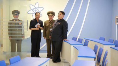 North Korean leader Kim Jong-Un (right) stands during a visit to a newly-built building of the Automation Institute of the Kim Chaek University of Technology in Pyongyang, in this undated picture released by North Korea's Central News Agency.