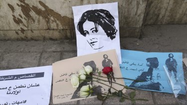Flowers are seen left at the spot where activist Shaima al-Sabbagh died during a protest in Cairo.