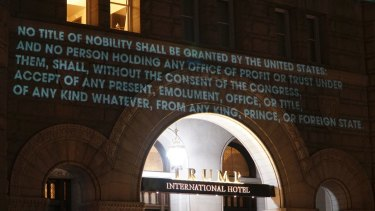 The Emoluments clause which aims to prevent foreign financial ties as projected onto the Trump International Hotel in Washington in May.