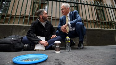 Prime Minister Malcolm Turnbull speaks to Kent Kerswell about the Ask Izzy app for homeless people in January 2016.