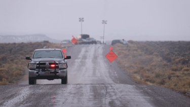A law enforcement vehicle heads away from a roadblock near the Malheur National Wildlife Refuge in Harney County, Oregon on Thursday.