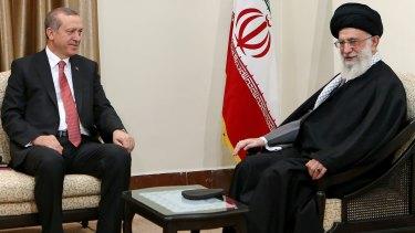 Iranian Supreme Leader Ayatollah Ali Khamenei, right, talks with Turkish President Recep Tayyip Erdogan in Tehran on April 7.