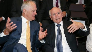 Prime Minister Malcolm Turnbull, left,  with former prime minister John Howard who is up in arms over  Ian Macfarlane's defection to the Nationals.