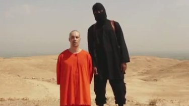 """""""The orange overalls are no accident."""" A frame from an Islamic State video."""