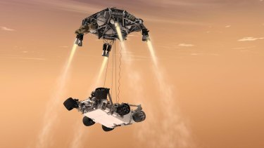 An artist's impression of NASA's Curiosity rover descending to Mars on a sky crane.