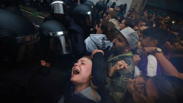 'A trap': Police push away Pro-referendum supporters outside the Ramon Llull school in Barcelona.
