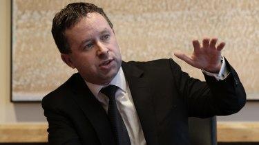 Qantas chief executive Alan Joyce defended the decision to keep base fares at the same level despite the falling oil price.