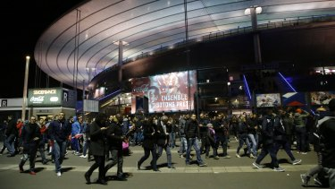 People leave the Stade de France stadium after the international friendly soccer France against Germany on Friday.