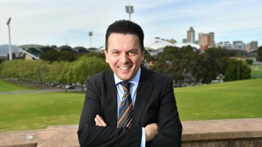 Nick Xenophon, posing for a photograph after announcing his plan to quit the Senate, could seize an influential role in South Australia.