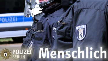 """An image posted by Berlin Police on Facebook, featuring the word """"human"""", along with a statement addressing the G20 incident."""