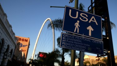 A sign directs pedestrians to the US border crossing in Tijuana, Baja California.