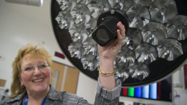 Barb Collins points out a high-definition camera built into a surgical light at the Humber River Hospital. The camera can transmit the surgery to specialists who are not in the operating room.