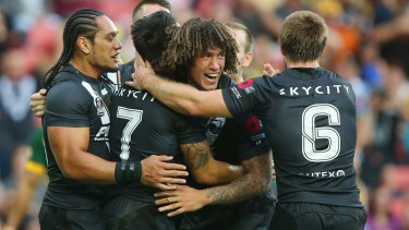 Slice of heaven: The Kiwis celebrate during their Trans-Tasman Test match against the Australia Kangaroos at Suncorp Stadium.