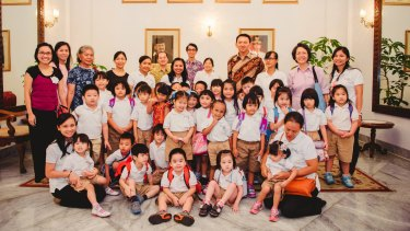 Ahok with the pupils of the Domba Kecil school in April 2016.