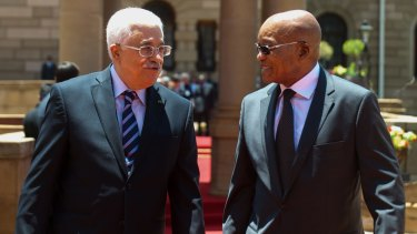 Palestinian Authority President Mahmoud Abbas, left, is received by South African President Jacob Zuma during a state visit to South Africa last week.