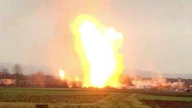 Flames billow from a gas station in Baumgarten, Austria, near the Slovakian border after the explosion.