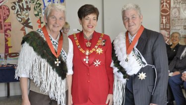 The New Zealand Governor-General Dame Patsy Reddy at the investiture of the Topp Twins - on the left, Dame Jools Topp, on the right, Dame Lynda Topp.