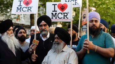 Members of the Manchester Sikh Community attend a vigil in Albert Square, Manchester.