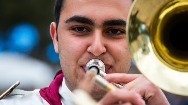 Follow the band: Mikhael Touma, 16, plays the Australian Syrian Youth Marching Band's sole trombone.