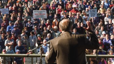 Former Prime Minister John Howard, wearing a bullet-proof vest under his jacket, fronts a rally at Sale at the height of the gun debate in 1996.
