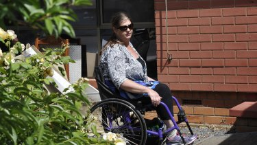 Hazel Passmore is seen leaving her property in Davoren Park, South Australia.