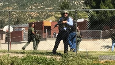 Emergency personnel respond to a shooting inside North Park School Elementary School.