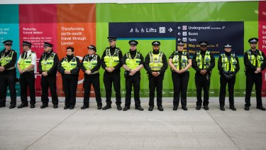 Police officers line up at London Bridge station on Tuesday to observe a minute's silence for the victims of the June 3 terror attacks.