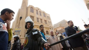 Policemen surround Mar Mina church, in Helwan, Cairo, Egypt where at least 11 people, including eight Coptic Christians, have been killed.