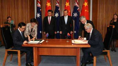 Chinese President Xi Jinping and then prime minister Tony Abbott witness the signing of the declaration of intent on the Australia/China Free Trade Agreement at Parliament House in Canberra.