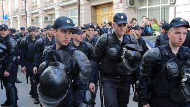 Security in authoritarian nations means also controlling the information space. Police officers cordon off a street at the presidential administration building during a protest in downtown Moscow, Russia.