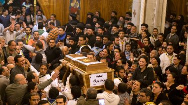 Relatives of Coptic Christians grieve as they carry the coffin of Nermin Sadek, one of the victims of the attack on the church known as Mar Mina near Cairo.