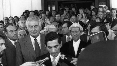 Gough Whitlam listens to David Smith read the proclamation dissolving Parliament.