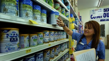 Cincotta Discount Chemist retail operations manager Nerissa Burns checks out the limited stocks of Bellamy's Organic Baby formula.