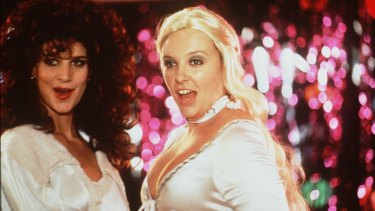 Rachel Griffiths (as Rhonda) and Toni Collette (as Muriel) during the famous Waterloo scene in <i>Muriel's Wedding</i>.