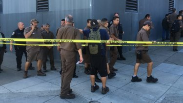 UPS workers gather outside after a shooting at warehouse in San Francisco.