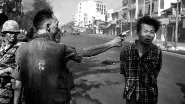 A South Vietnamese general executes a Viet Cong officer with a single pistol shot in Saigon in 1968.