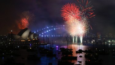 The midnight New Year's Eve fireworks over Sydney Harbour, viewed from Mrs Macquarie's Point in Sydney.