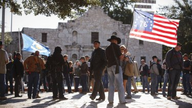 What's in a name? Demonstrators, some with rifles, gather for a pro-gun rally at the Alamo in San Antonio.