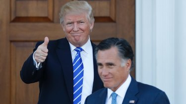 President-elect Donald Trump gives the thumbs-up as Mitt Romney leaves a meeting last month.