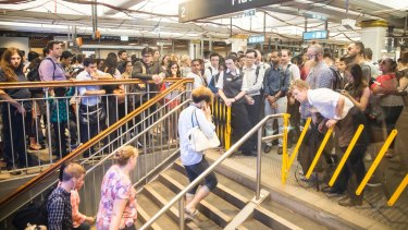 Station staff at Town Hall temporarily stop commuters from entering the platforms last week to avoid dangerous overcrowding.