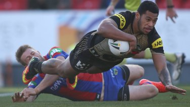 Insult to injury: Waqa Blake adds to the Panthers' misery at Hunter Stadium.
