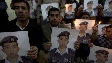 Family of Jordanian pilot Muath al-Kasasbeh with posters of him last week.