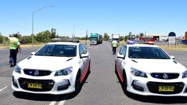 Police divert traffic from the scene of the crash near Dubbo.
