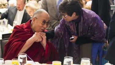 The Dalai Lama meets Valerie Jarrett, senior adviser to the US President.