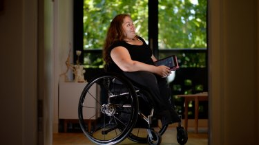 Bree Synot in her disability-friendly home in Abbotsford. Using her ipad, she can open the front door to visitors from wherever she is in the house - or even outside it.