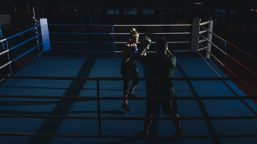 Fighting fit: Paralympic rower, Kathryn Ross, works in the combat centre at the AIS with boxing coach, Paul Perkins.