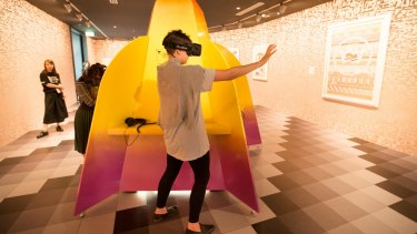 A visitor to the NGV tests out Jess Johnson's new virtual reality exhibition Wurm Haus.