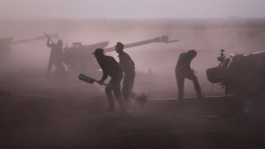 Syrian army personnel load howitzers near the village of Murak in Hama province earlier this month.