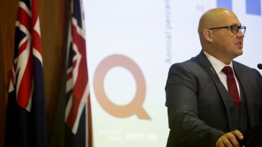 Queensland Treasurer Curtis Pitt briefing journalists on his 2017-18 state budget.
